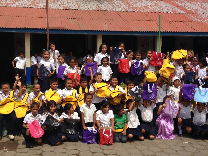 Young students at a school in Nicaragua receive donated backpacks from a Thriive business. Thanks to the donations, enrollment at this school has doubled.