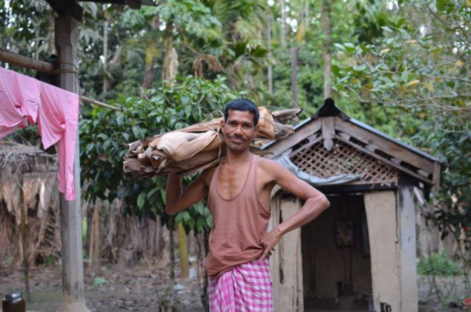 Ajit Das with a pile of freshly collected arecanut leaves. He and Chandra employ six youth leaf collectors on a part-time basis. They hope to increase their volume over the next year and create more opportunities for their neighbors in Barangabari Village.